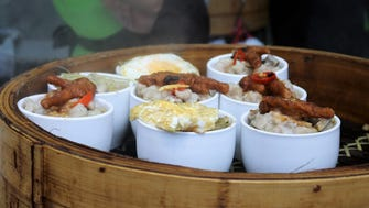 Small bowls from street stalls may be loaded with a variety of treats, such as dumplings, chicken feet, eggs or fried rice.