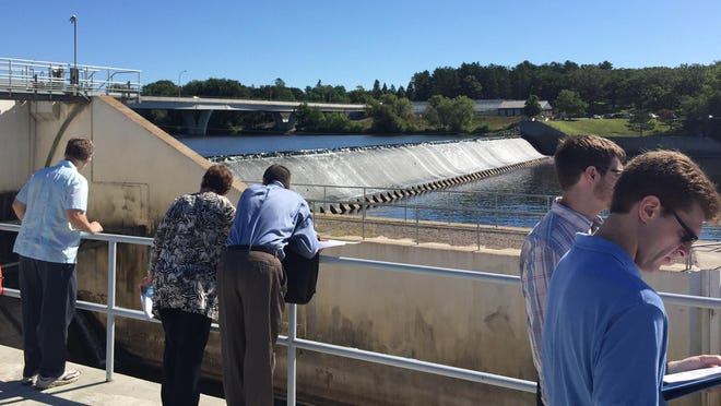 Members and staff of the House capital investment committee inspect the St. Cloud dam on Tuesday. The committee visited the dam, prison and St. Cloud State University on a tour of projects seeking bonding money in 2016.
