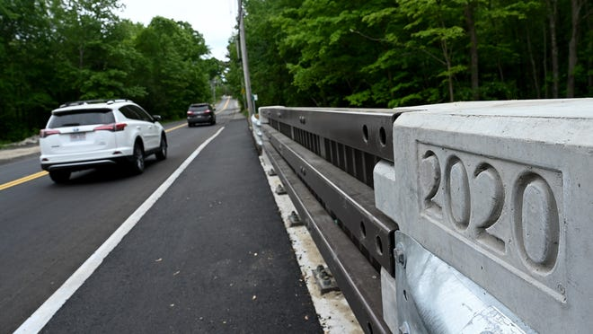 Cars cross the newly reopened Fisher Street bridge Tuesday in Westborough.