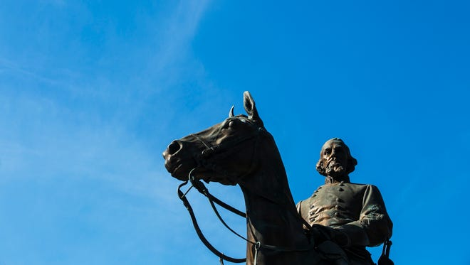 The statue of Nathan Bedford Forrest stands at Health Sciences Park in Downtown Memphis on Oct. 5, 2017. The contentious fight over removal of Confederate statues and monuments in Memphis has been ongoing for the last four years.