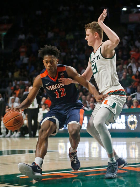Virginia guard De'Andre Hunter (12) drives to the basket past Miami forward Sam Waardenburg (21) during the second half of an NCAA college basketball game, Tuesday, Feb. 13, 2018, in Coral Gables, Fla. Hunter scored 22 points as Virginia defeated Miami 59-50. (AP Photo/Wilfredo Lee)