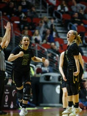 Iowa City, West's Lauren Zacharias (4) reacts after