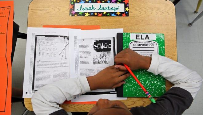 Fourth-grader Isaiah Santiago, 8, listens to his assignment during an ELA lesson, Oct. 3, 2012 at King Street Elementary School in Port Chester.