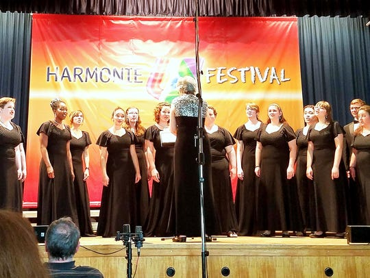 Members of the Mansfield University Choir perform at
