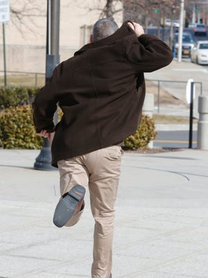 Former Patterson Fire Department Treasurer Albert Melin runs out of the White Plains Federal Courthouse after being sentenced to 33-months in Federal prison   on Feb. 3, 2017.