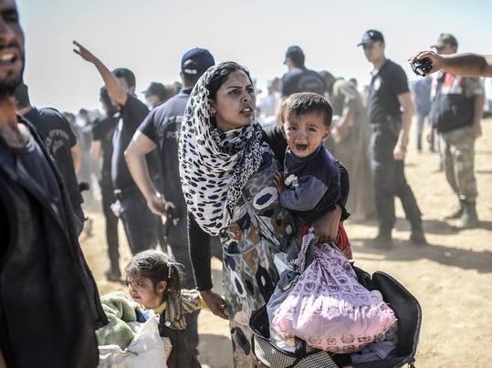 TOPSHOTS-TOPSHOTS 2014-SYRIA-TURKEY-IRAQ-KURDS-CONFLICT-REFUGEES