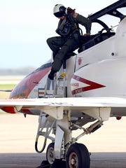 A pilot exits a T-45 Goshawk after flying March 5, 2015, at the Naval Air Station Kingsville.