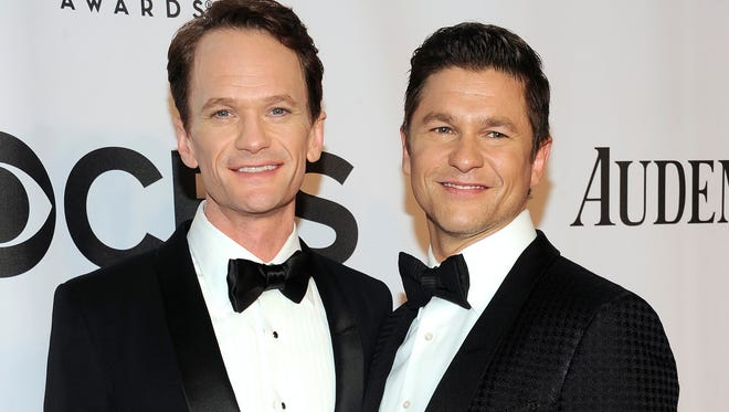 In this June 8 file photo, Neil Patrick Harris, left, and David Burtka arrive at the 68th annual Tony Awards at Radio City Music Hall in New York. The 'How I Met Your Mother' star and his actor-chef groom were married Saturday in Italy. They'd been dating for 10 years and are parents to 3-year-old twins, Gideon and Harper.