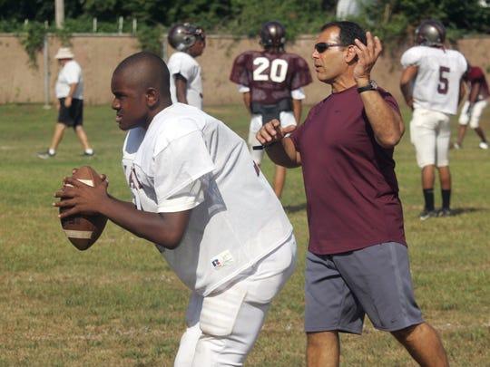 Matawanhead coach Joe Martucci instructs quarterback Brian Robinson during a 2005 practice.