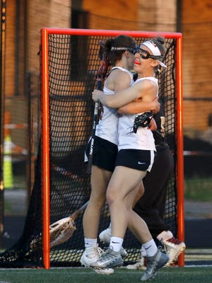 Ithaca's Mackenzie Rich, left, and Danielle Hemly celebrate a goal against Corning on May 23 in the Section 4 Class A girls lacrosse championship game at Corning Memorial Stadium.