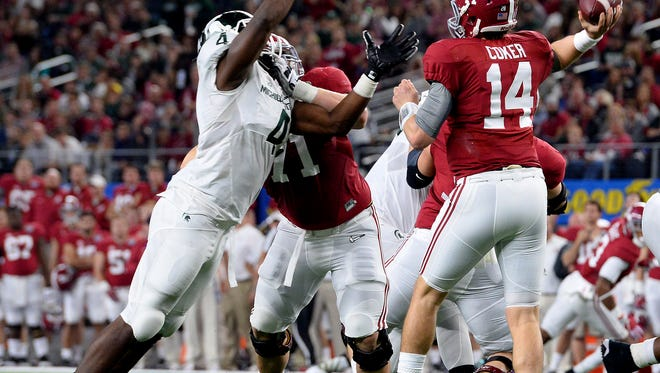 Spartans Malik McDowell (4) gets pressure on Alabama quarterback Jake Coker (14) as he throws a pass in the first half of the 80th Annual Cotton Bowl Classic between Michigan State and Alabama Thursday, December 30, 2015 in Arlington, Texas.