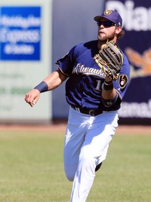 Brewers right fielder Kirk Nieuwenhuis makes a running catch to put out Seattle Mariners Jarrod Dyson during a spring training game.