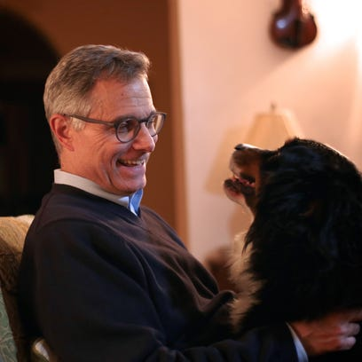 Federal judge Terrence G. Berg and his son, Theodore Berg, 17, go for a walk with family dog, Rusty, on Thursday, Nov. 19, 2015, in Detroit.