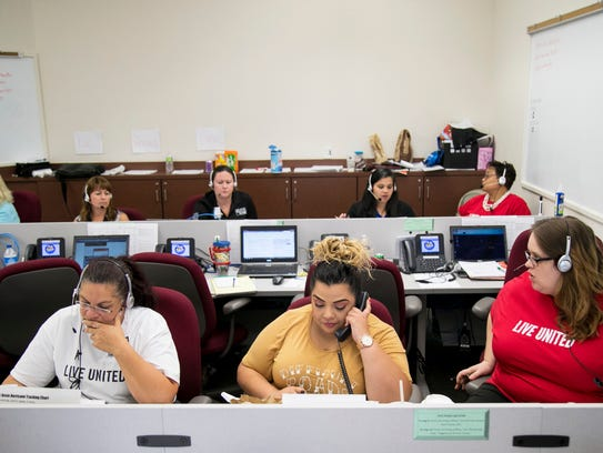 United Way employees and volunteers answer calls to