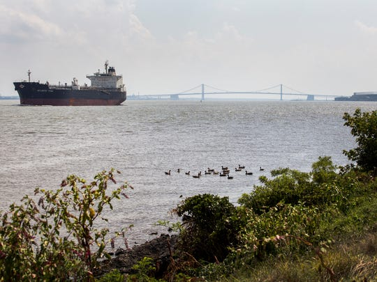 The Atlantic Titan, a tanker ship, sails north on the Delaware River past the Delaware Memorial Bridge near Edgemoor on Aug. 16. Economic development at the Port of Wilmington has become a campaign issue in the race for New Castle County executive.