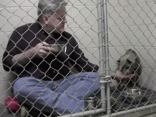 Vet Gets Into Cage With Dog