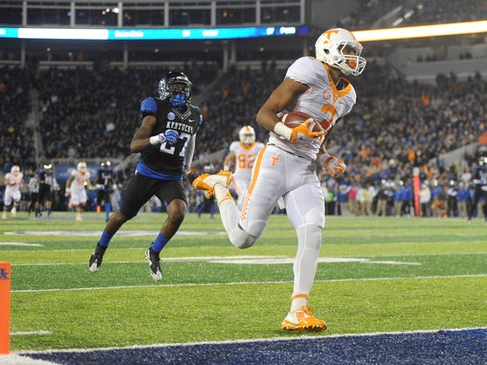 Tennessee wide receiver Josh Malone scores a touchdown past Kentucky safety Mike Edwards to give Tennessee a 17-14 lead during the first half at Commonwealth Stadium in Lexington, Ky. on Saturday, Oct. 31, 2015.
