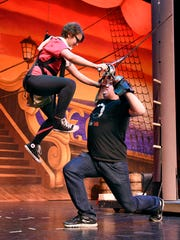 Peter Pan, played by Grace Knoblach, flies during a