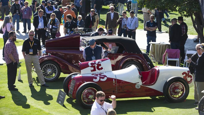 Guests look at cars on display during the Arizona Concours D' Elegance car show at the Arizona Biltmore January 24, 2016.