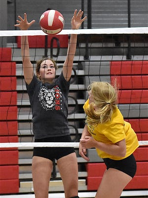 Abby Wheeler gets high for a block during Minerva's first official volleyball practice on Aug. 1.