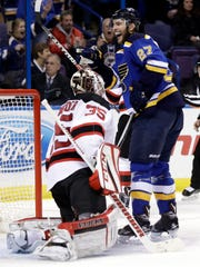 St. Louis Blues' Alex Pietrangelo (27) smiles after scoring past Devils goalie Cory Schneider on  Thursday, Dec. 15, 2016, in St. Louis.