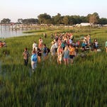Steve Shoul of Richmond, Virginia points out a spot in the marsh to his wife Amy Kelley before the 90th annual pony swim on Chincoteague, Virginia on Wednesday, July 29, 2015.