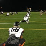 Cocoa High players warm up