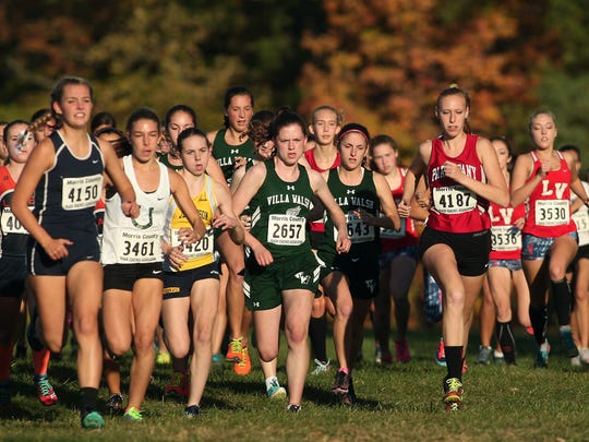 Surprise winner Mary Lynch of Villa Walsh, c, in the Northwest Jersey Athletic Conference varsity girls small school cross country championships at Greystone Park. October 20, 2015, Morris Plains, NJ