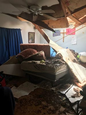 The aftermath from when a palm tree snapped in half and crashed through the ceiling of a Litchfield Park home July 30. 2018.