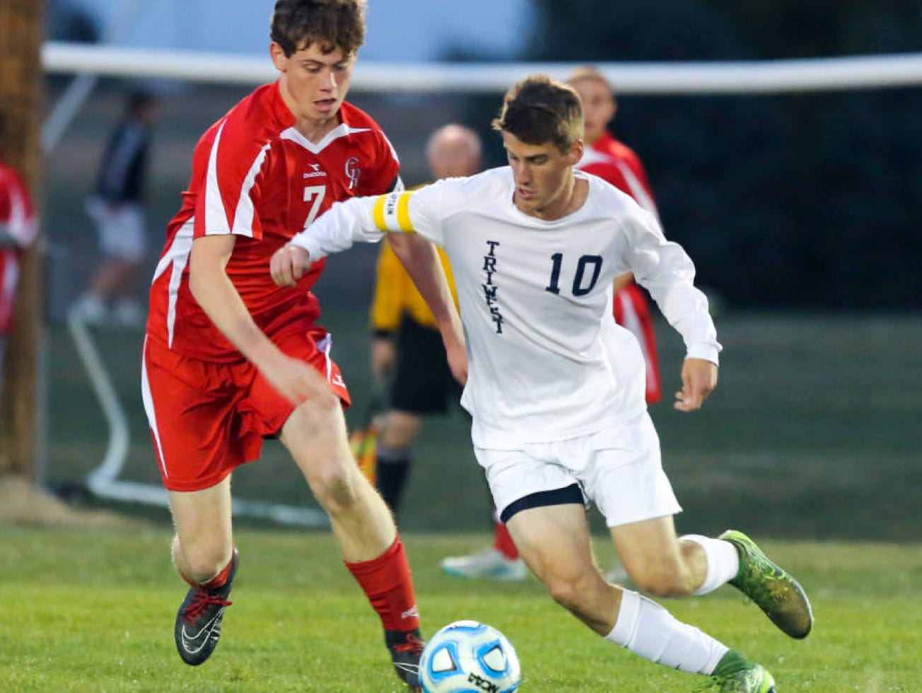 Cardinal Ritter's Keith Owen tries to get the ball from a Tri-West player.