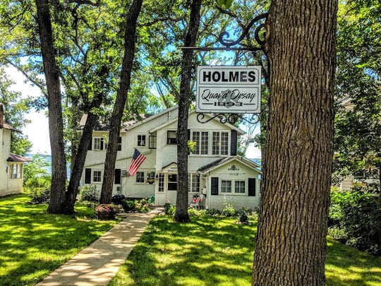 The front of the Holmes cottage where a sign hangs
