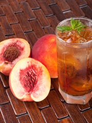 Stacie Stewart of MilkWood prefers bourbon and sweet tea (peach-infused for summer).