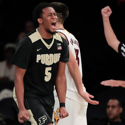 Purdue forward Basil Smotherman (5) reacts after scoring