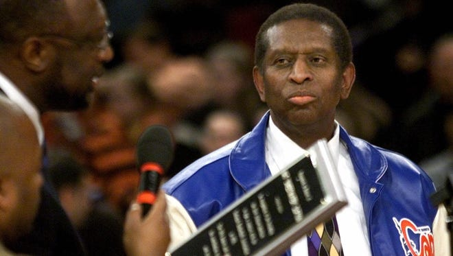Earl Lloyd, right, is honored with a plaque from Bob Lanier during a ceremony Oct. 31, 2000.