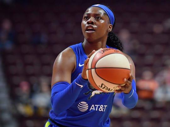 The Dallas Wings' Arike Ogunbowale eyes the basket during a preseason WNBA game.