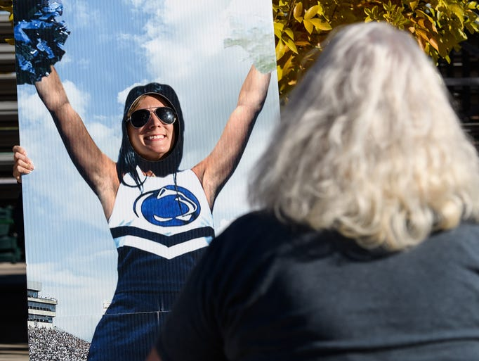 Penn State fans pose for pictures before the start