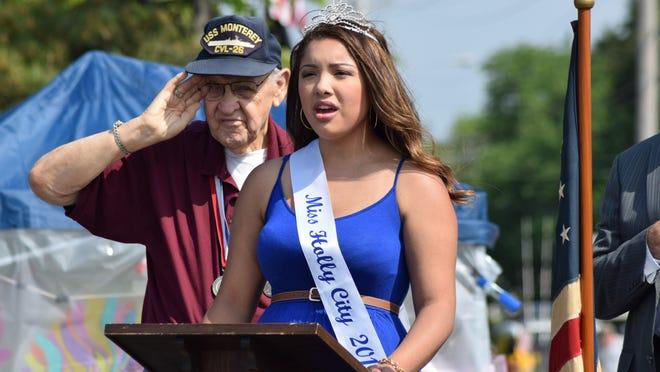 Owen Garrison of Upper Deerfield salutes as Miss Holly City 2015 Alyssa Lopez sings the National Anthem.