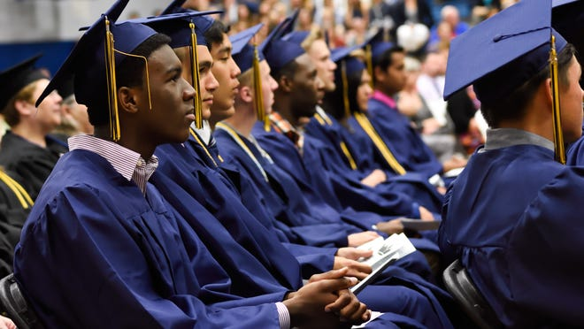 Graduates of Regina High School's Class of 2015 maintain their attnetion at Sunday's commencement ceremony.