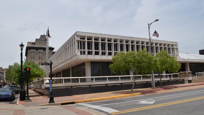 "A plan offered to enhance downtown development recommends tearing down Alexandria City Hall (foreground) to make way for a ""Town Center Green"" open area. The City Hall building, which is 51 years old, is in need of various repairs, officials say."