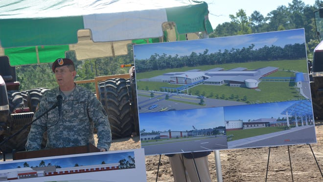 At a groundbreaking ceremony in 2014, then JRTC and Fort Polk commanding general Brig. Gen. William Hickman stands by renderings of the new building for South Polk Elementary, which will become Parkway Elementary when it opens in August 2016.