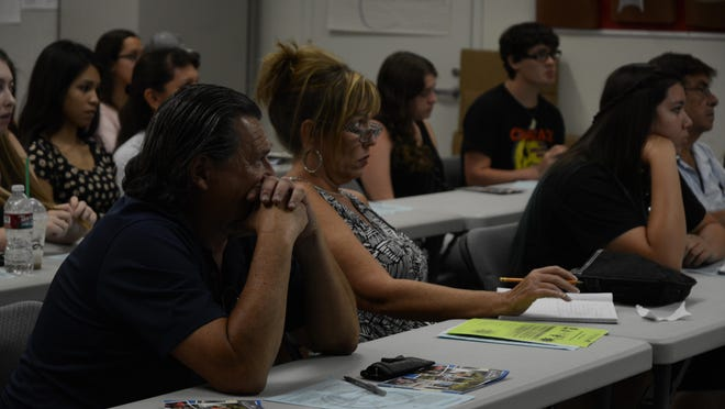 Parents and students learn about applying to college in the Cal State University system at the parent center in Palm Springs Unified School District, Tuesday, July 28, 2015.