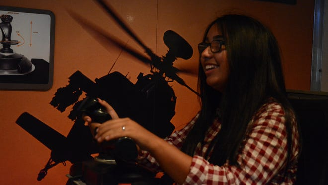 A Shadow Hills High School student operates a flight simulator for an Unmanned Aerial Vehicle, or UAV.