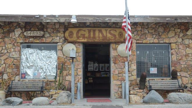 The flag at Desert Hot Springs' Condor Gun Shop flew at half-mast on Friday Dec. 4, 2015.