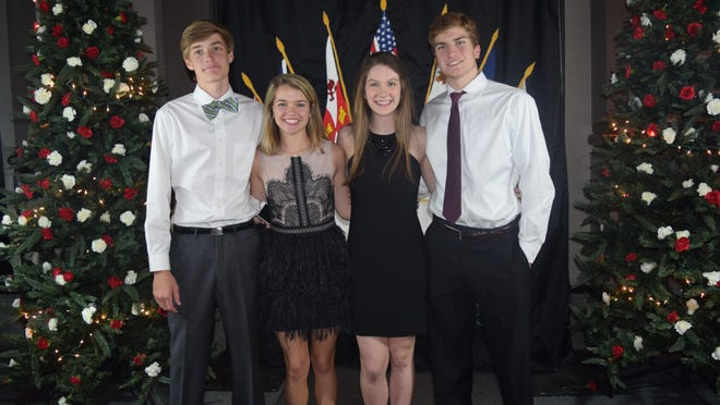 From left, Montgomery Assembly honoree Mac Parsons enjoyed the 55thAnnual Holiday Dance with his date, Mary Emily Byrd, and honoree Annie Skoneki and her escort, Stephen Sadie.