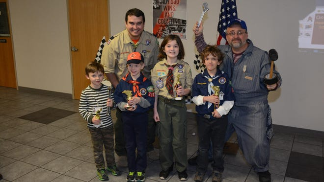 "Winners of ""Best Design"" in the Pinewood Derby were Tadhg Kenny, Jonah Rettig, Jeremiah Barth and Jack Theus."