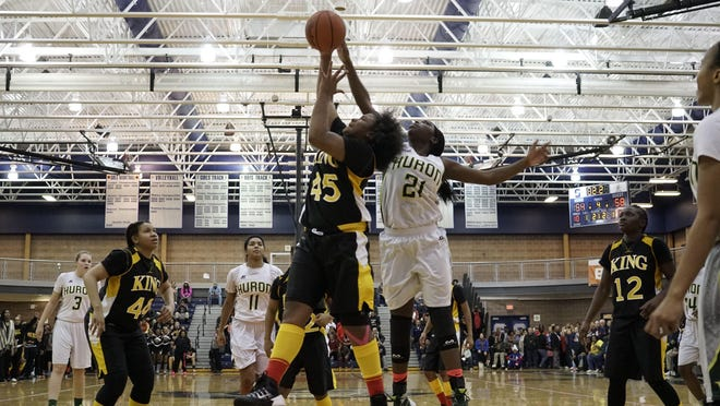 Detroit King's Jordan Lewis, left, and Ann Arbor Huron's Shamim Wambere go up for a rebound on Tuesday.