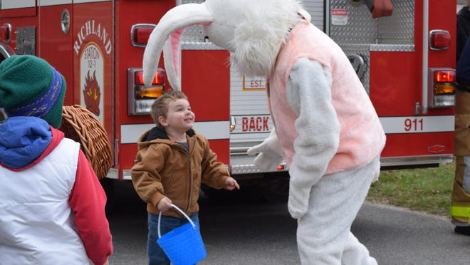 John Spinnato, 4, of Richland, greets the Easter Bunny seconds after he arrived at the Buena Vista Township Easter Egg Hunt at Michael Debbi Park in Richland on Saturday.