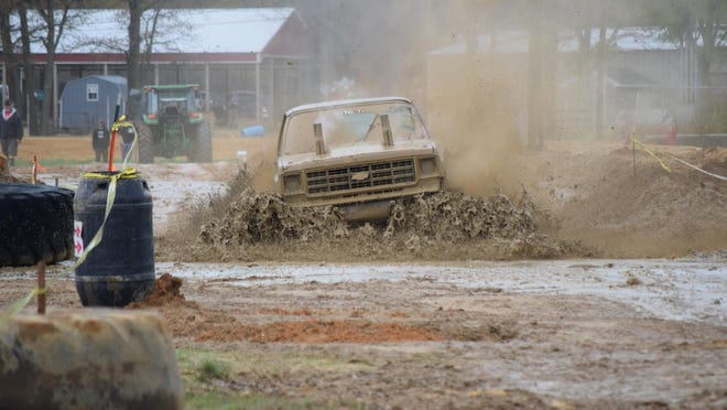 Mike Blazer of Whippany takes on the new permanent mud bog at the Cumberland County Fairgrounds during the Hill and Hole Mug Bog.