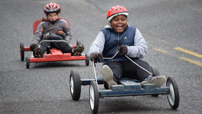 Josiah Suggs, 9, of Millville, shrieked with excitement when he took the lead in a race during the Soap Box Derby in Millville.