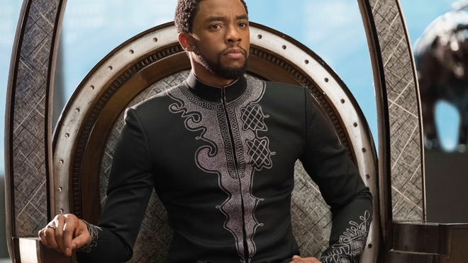 "Chadwick Boseman stars as T'Challa in ""Black Panther."" Marvel Studios-Disney via AP This image released by Disney shows Chadwick Boseman in a scene from Marvel Studios' ""Black Panther."""
